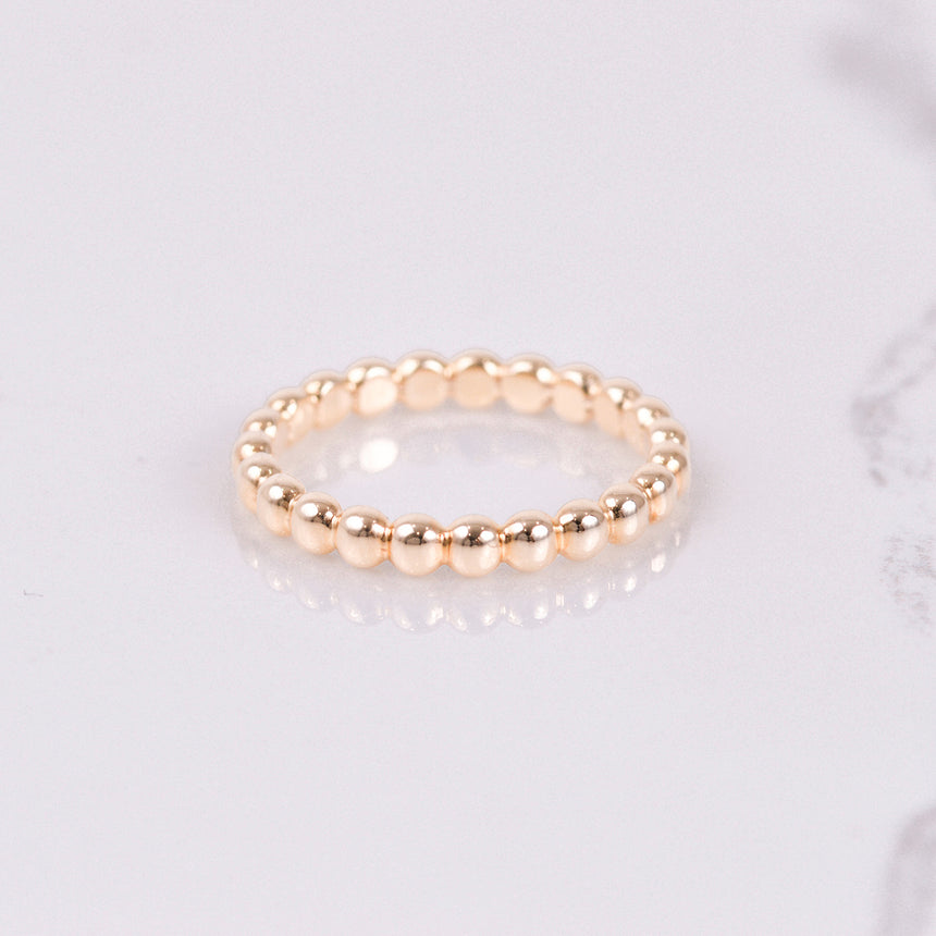 yellow gold beaded stackable eternity band