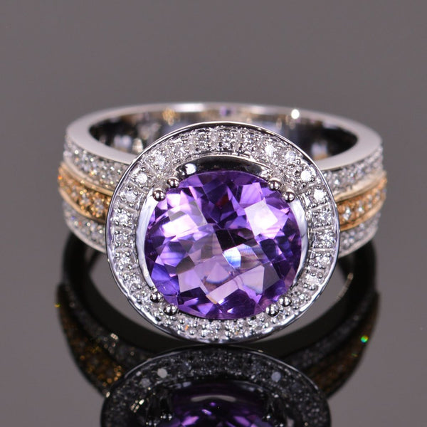 round amethyst and diamond ring in 14k yellow and white gold