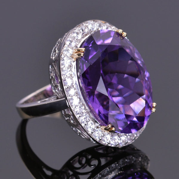 Oval amethyst ring with white sapphire halo in white gold