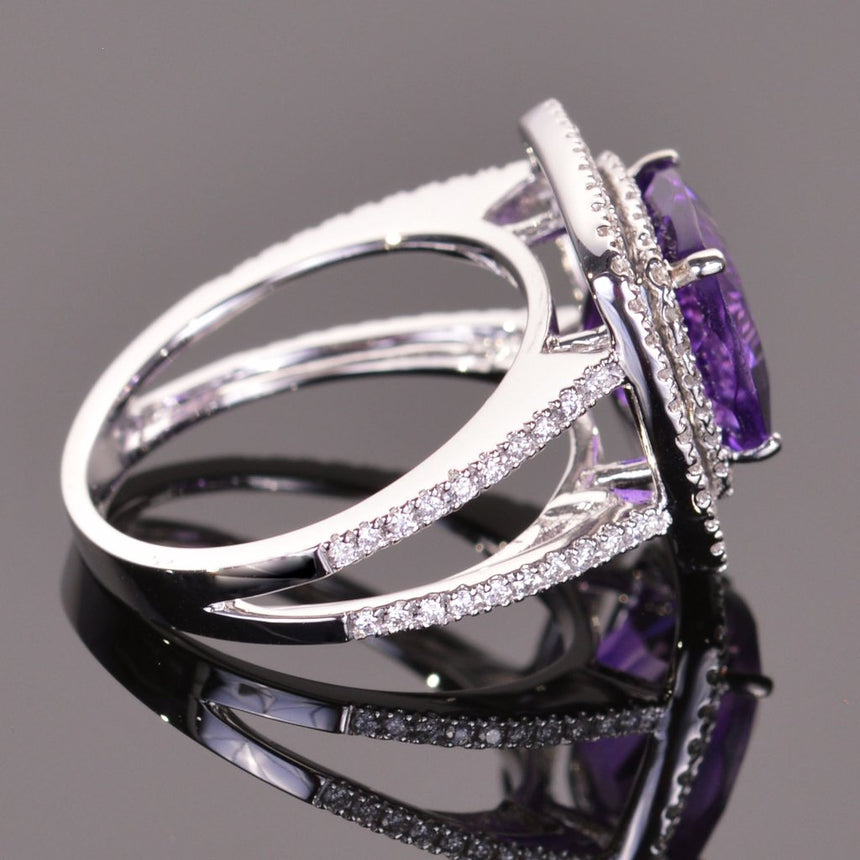 cushion amethyst ring with diamond double halo in white gold.