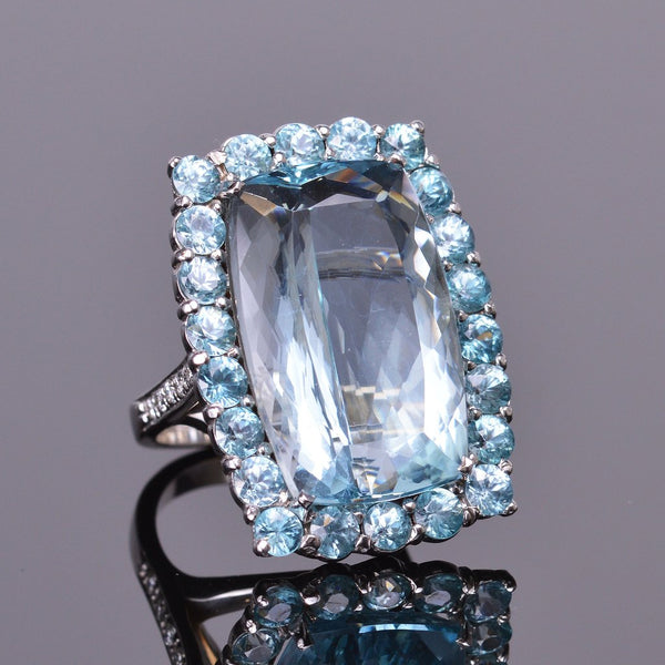 aquamarine ring with blue zircon halo in white gold