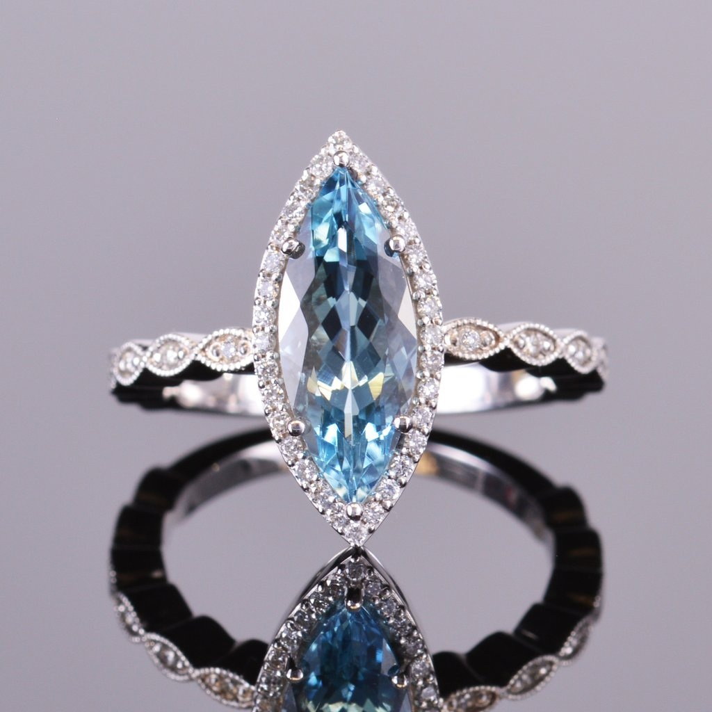 marquise aquamarine ring with diamond halo in white gold