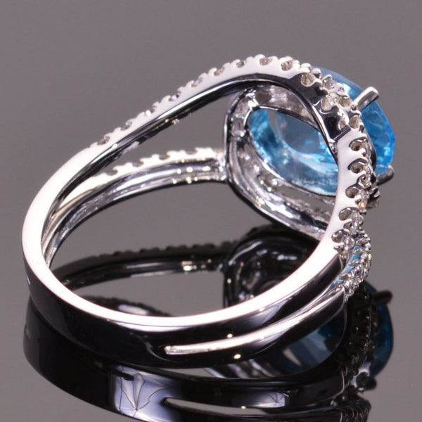 Blue Topaz and Diamond Infinity Ring in white gold