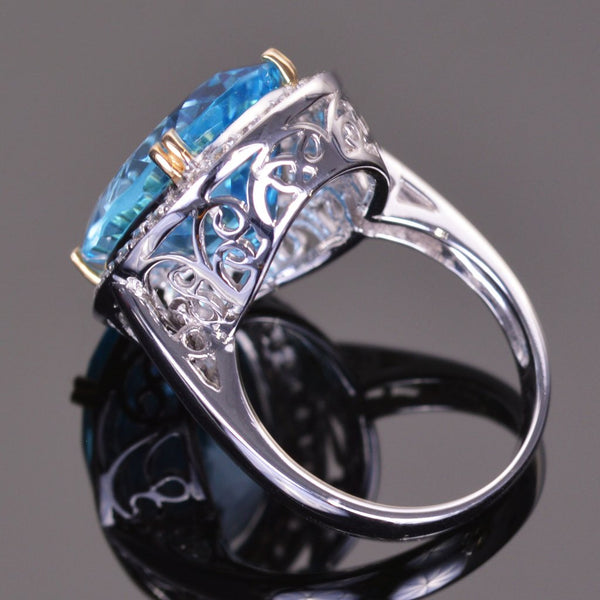 oval blue topaz ring with white sapphire halo in white gold