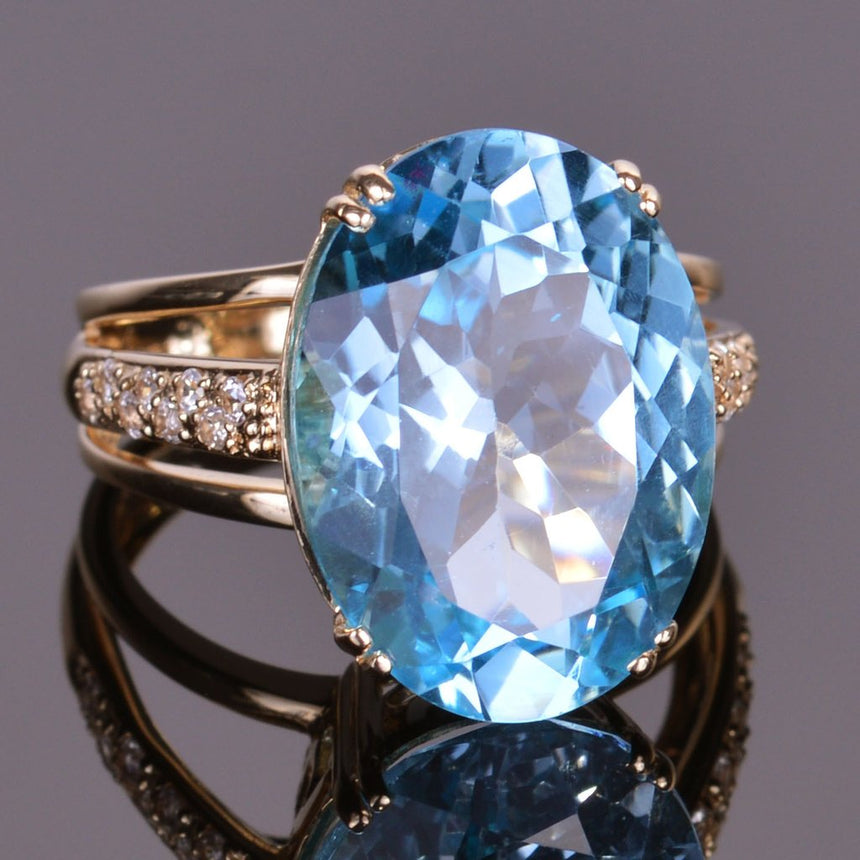 Blue Topaz and White Sapphire Oval Ring in Yellow Gold