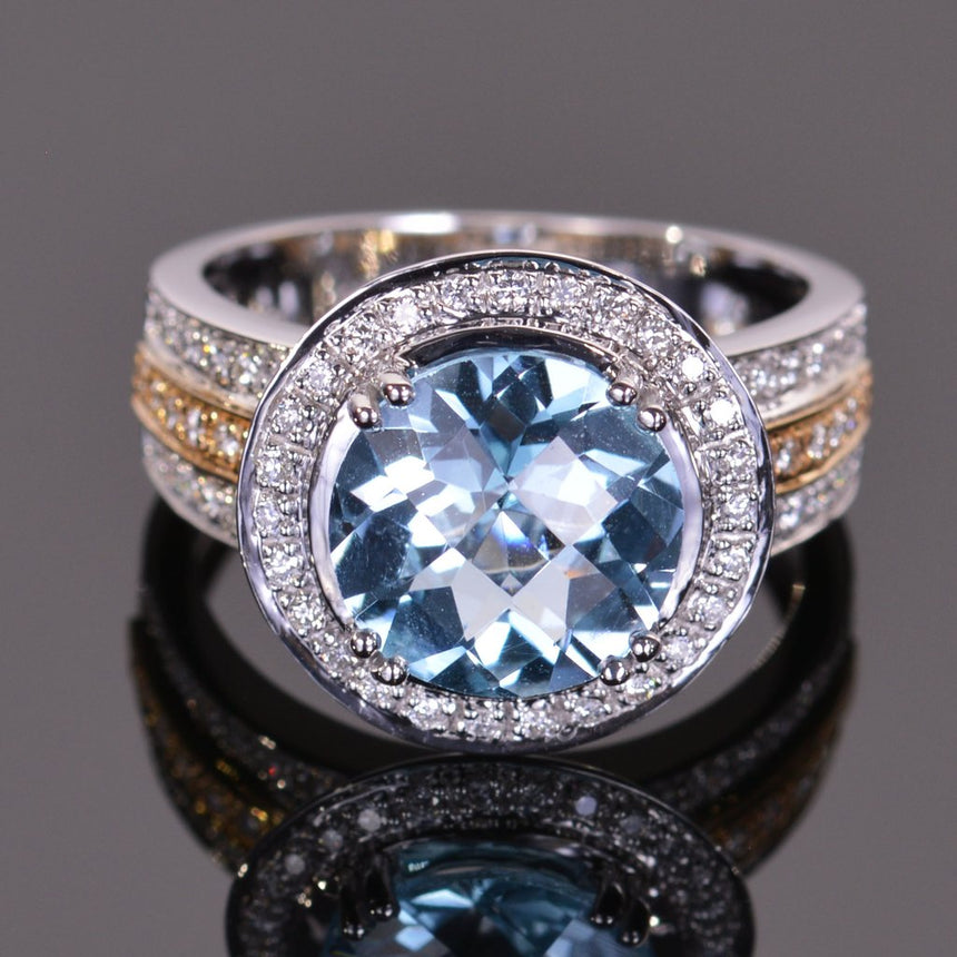 round blue topaz and diamond ring in yellow and white gold