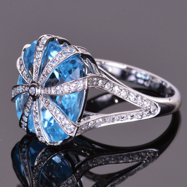 cushion blue topaz and white sapphire ring in white gold