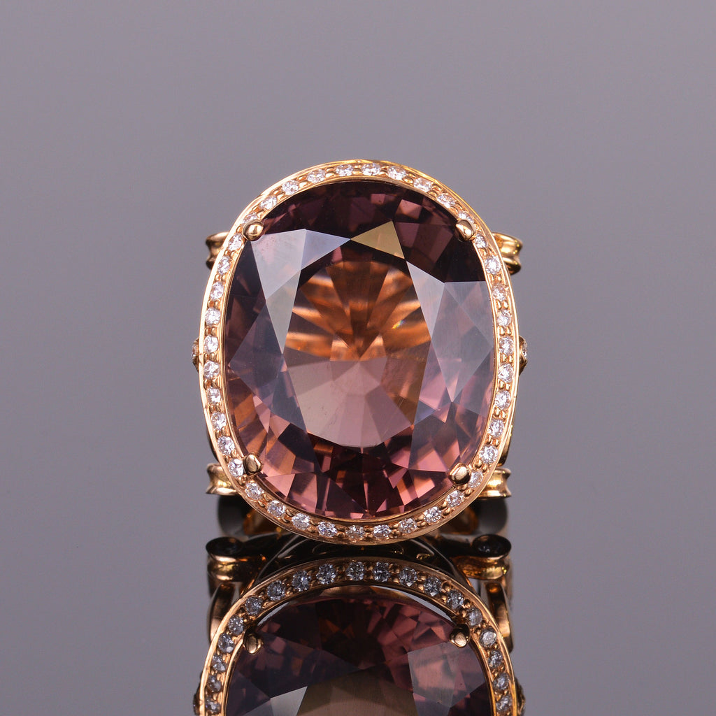 oval brown tourmaline and diamond ring with fleur de lis in rose gold