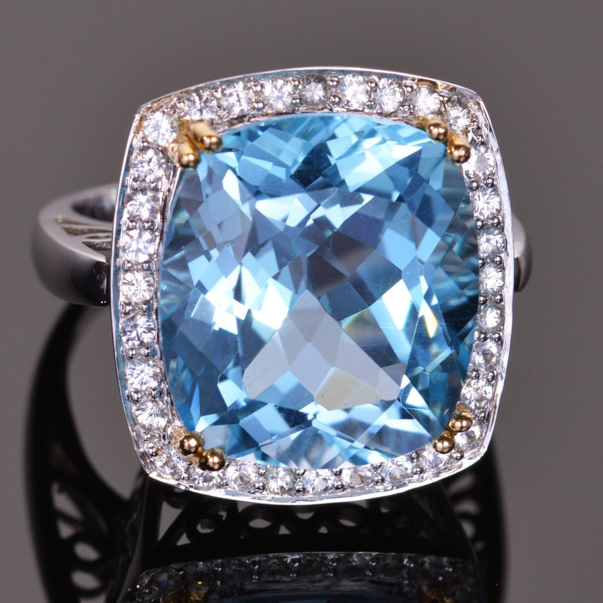cushion blue topaz and sapphire halo ring