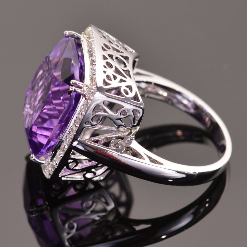 cushion amethyst ring with sapphire halo in white gold