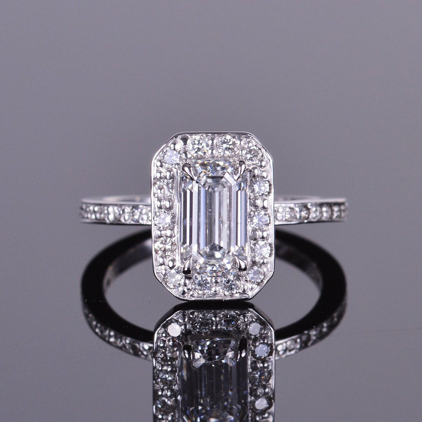emerald cut diamond engagement ring with diamond halo