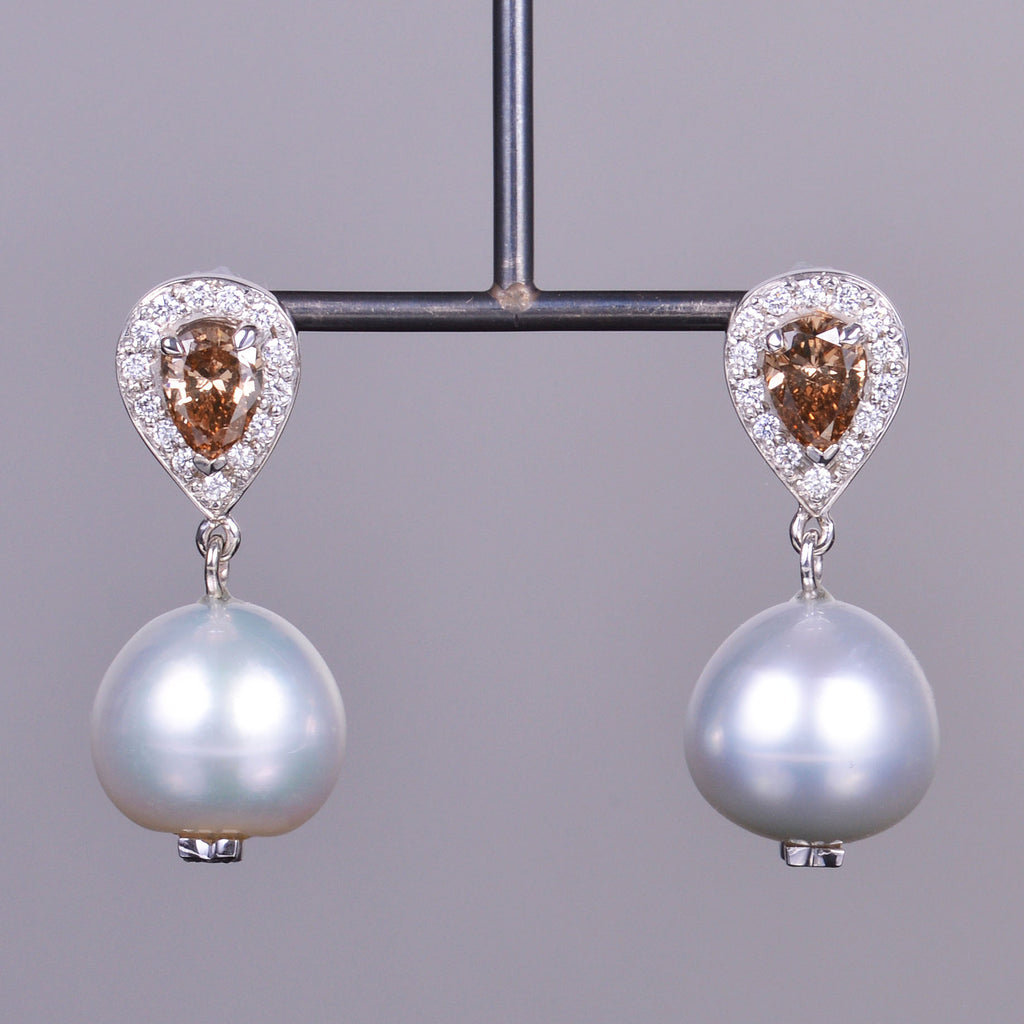 pear diamond and pearl dangle earrings in white gold