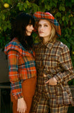 Orange and green plaid coats