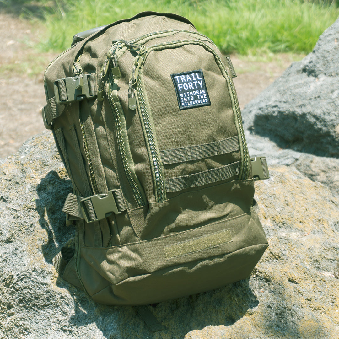 Expandable Backpack | Green | Faith inspired apparel and gear. Christian clothing and backpacks. T-Shirts, Sweatshirts, and Bags. TRAIL FORTY | WITHDRAW INTO THE WILDERNESS | Luke 5:16 | TRAILFORTY.com
