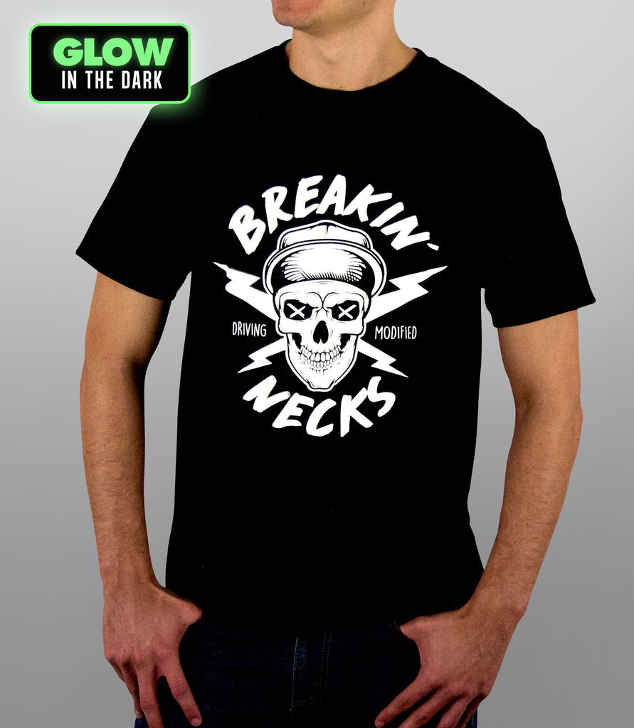 A t-shirt with a skull and thunder bots, reading breaking' necks, silkscreened in glow in the dark paint