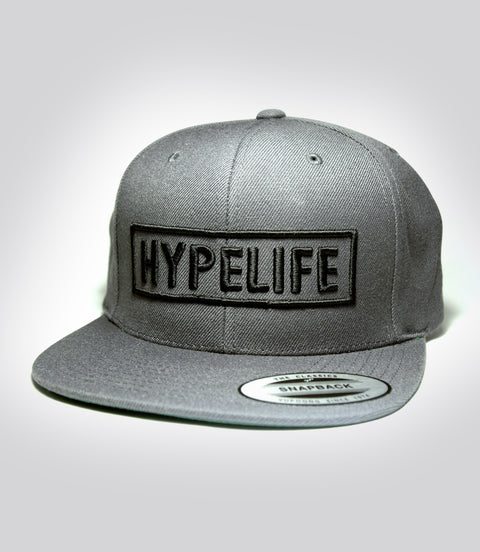 Black HypeLife Block puff embroidery on grey snap back hat
