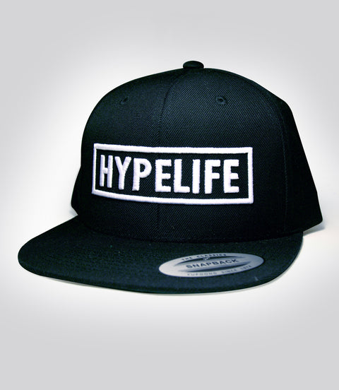 White HypeLife Block puff embroidery on black snap back hat