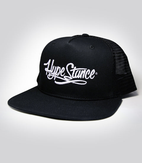 White HypeStance script puff embroidery on a black trucker hat