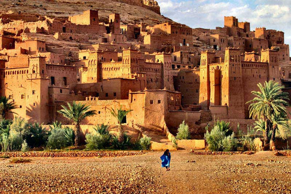 Woman walking towards the ksar at Aït Benhaddou