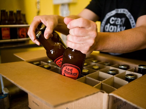 Red Donkey beer being packed by the Santorini Brewing Company