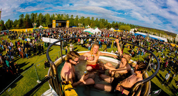People enjoying the geothermal pool at the Secret Solstice Festival. In the background, other people attending the festival are visible.