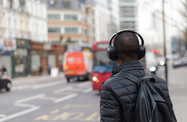 Man with headphones walking about in the city