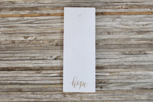 Backer — White HOPE gold lettering