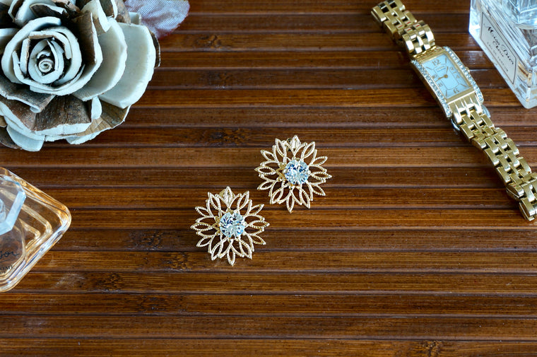 Golden floral earrings divus