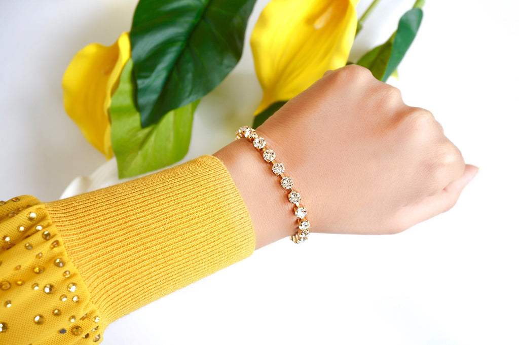A bracelet with matching stud earrings