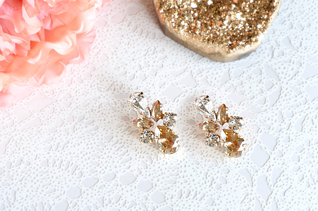 Gold white crystal earrings from divus india on Instagram