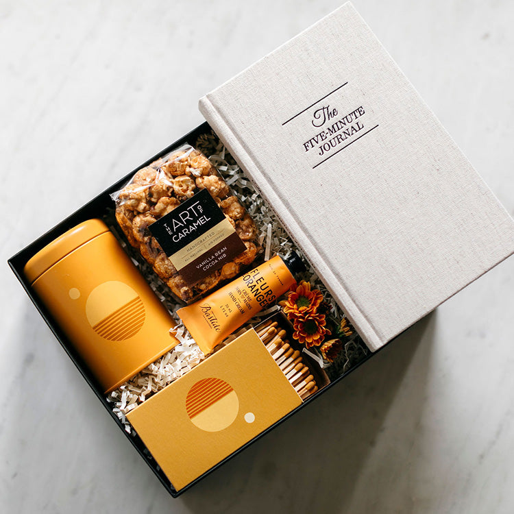 Keep them looking on the bright side with this cheerful collection of treats! Bright, tranquil scents paired with comforting treats, intensely hydrating hand cream & a gratitude journal will lift spirits when they need it most. A care package by Just Hit Send