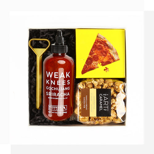 It's always happy hour with this gift packed full of fun! A tricky jigsaw pizza puzzle pairs well with cocktails, caramel corn, and spicy sriracha to put on just about anything. Cheers!