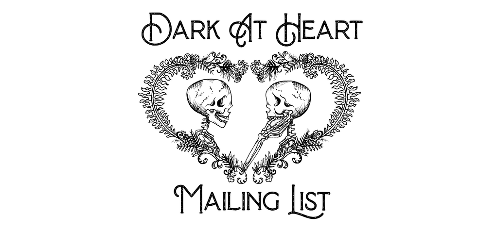 Text reads Dark At Heart Mailing List with an illustration of two skeletons lovingly looking at each other