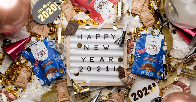 A signboard with 'Happy New Year 2021' written on it, surrounded by ChocZero chocolate