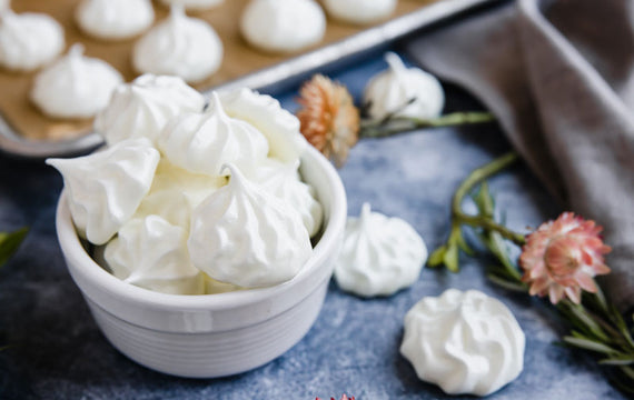 A bowl holding delicate sugar free meringue cookies