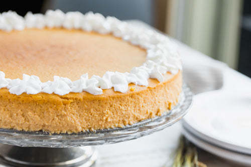 A low carb cheesecake topped with whipped cream