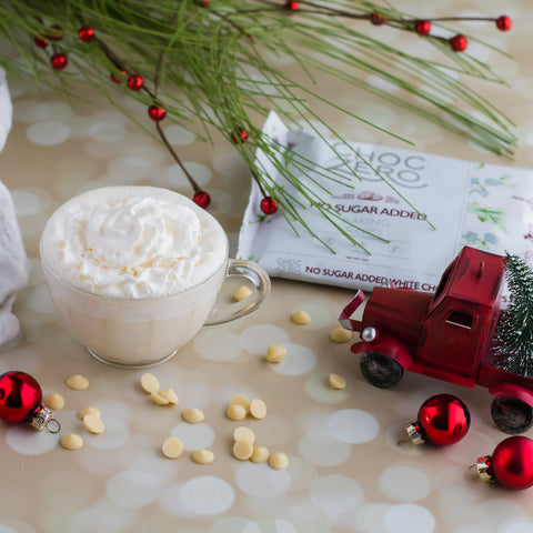 Sugar Free White Hot Cocoa surrounded by festive decorations