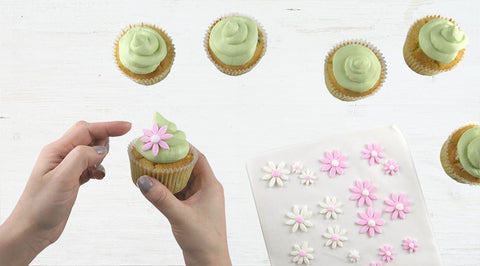Use the fondant flowers to cover any imperfections in the piped buttercream!