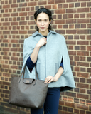 Large brown leather tote bag by Maasai Colour, worn by model