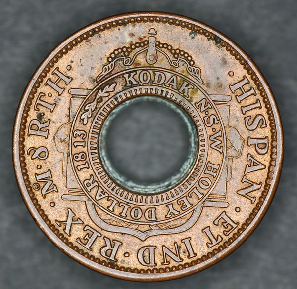 Kodak. Holey dollar token.