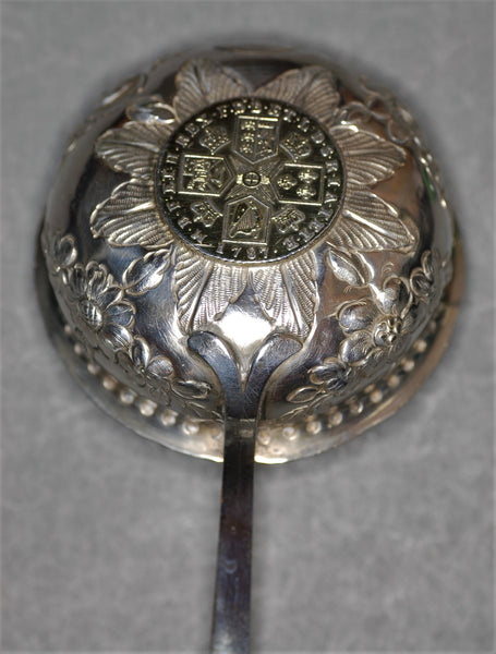 Georgian toddy ladle with inset 1787 gilt shilling.