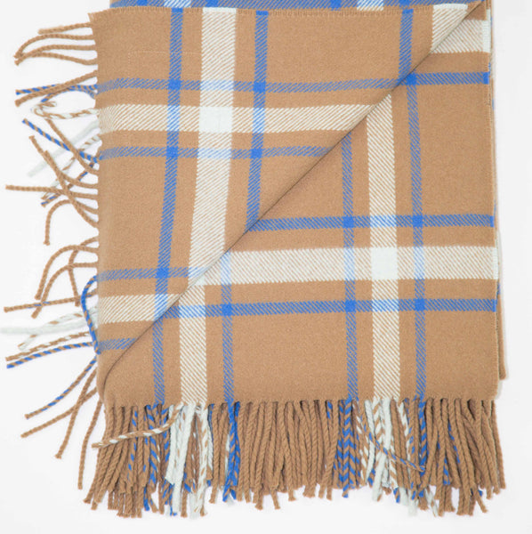 A checked wool throw in cinnamon, beige, brown and blue, cobalt