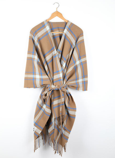 A checked wool cape with a cinnamon ground, highlighted by sky and cobalt blue.