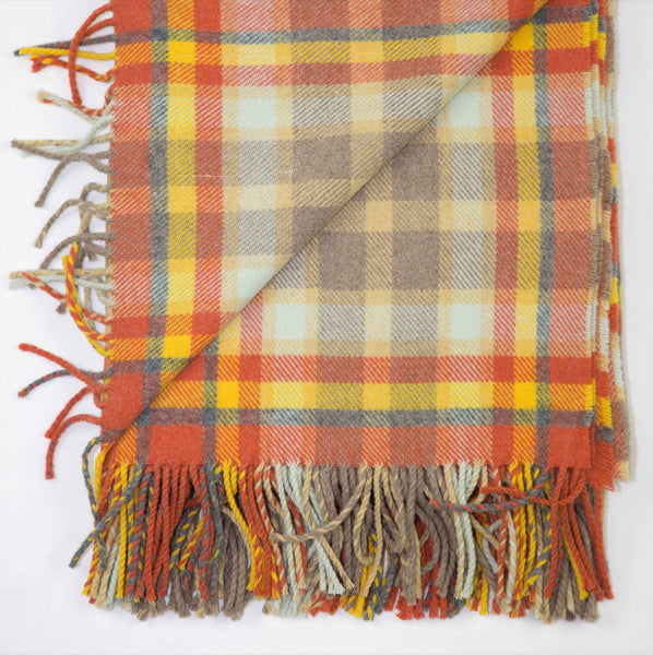 Wool throw designed in Scotland with a bold check of gold and natural tones