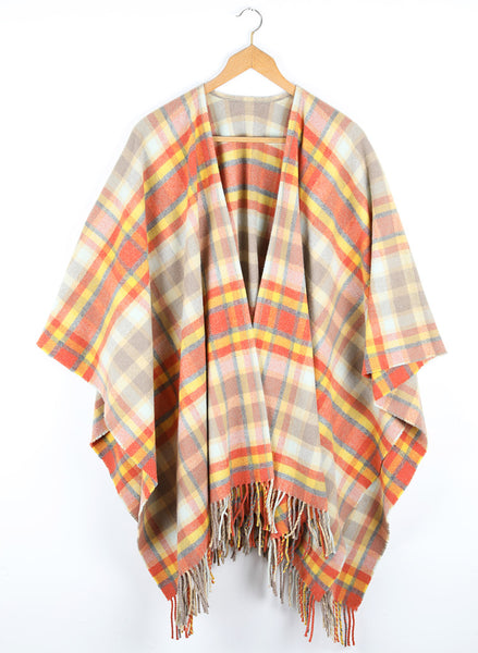 A wool cape with a bold check of golds complimented by natural tones and granite.