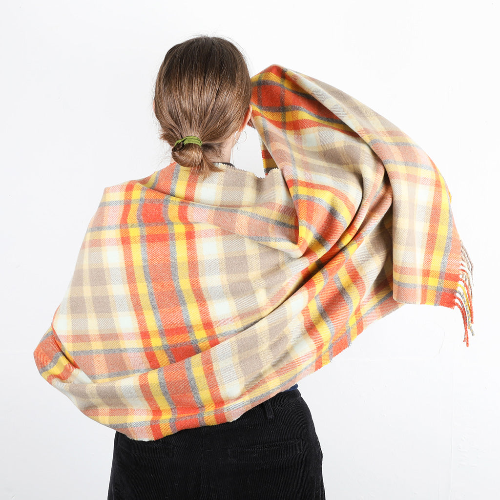 Wool shawl/stole with a bold check of golds complimented by natural tones and granite.