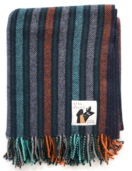 Striped blanket in navy, turquoise, grey and orange