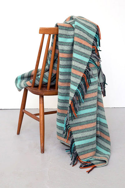 Striped blanket in grey, aqua, orange and blue