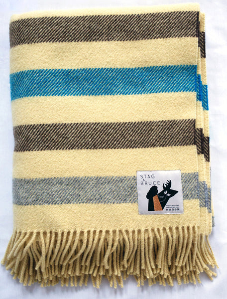 Striped wool blanket in cream, blue, brown and grey