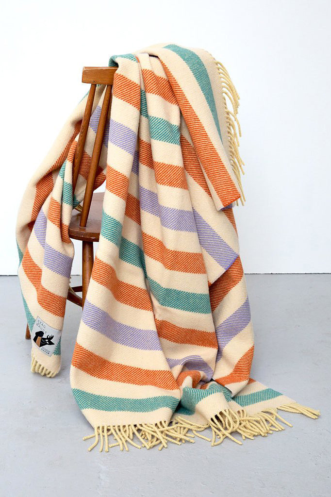 Striped blanket in cream, lilac, orange and blue